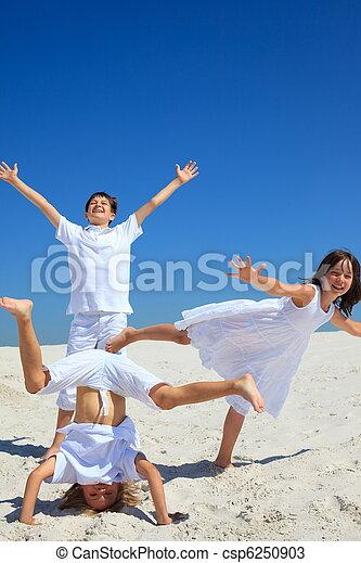 Happy siblings on beach - csp6250903
