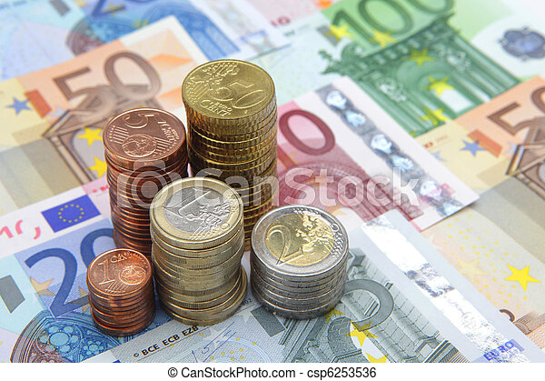 Stacks of Euro coins on Euro banknotes  - csp6253536