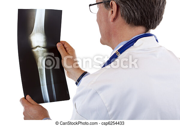Back view of a doctor studying knee x-ray - csp6254433