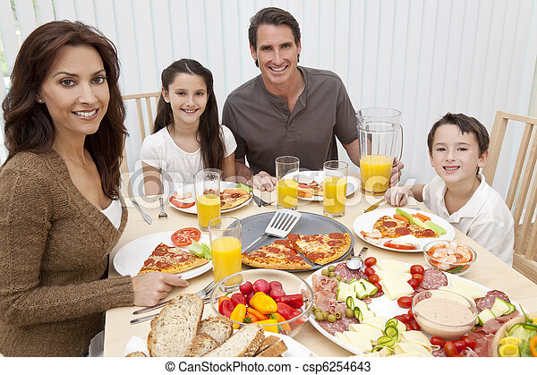 Parents Children Family Eating Pizza & Salad At Dining Table - csp6254643