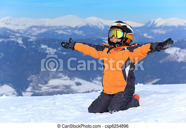Young skier on snowy mountain - csp6254896