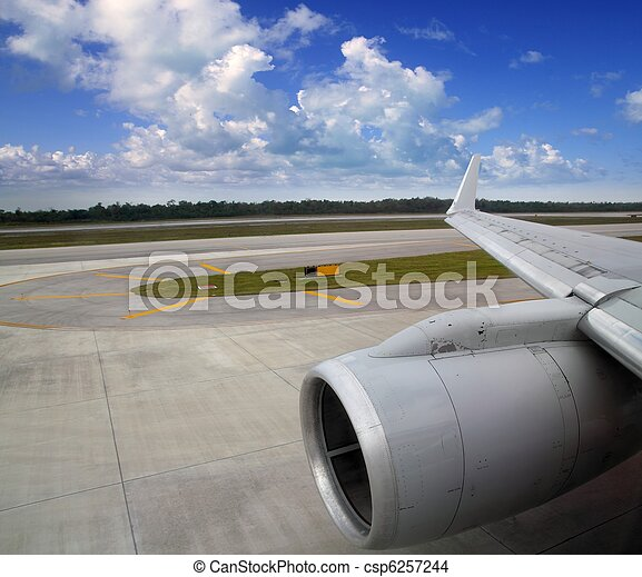 airplane in landing runway road plane wing - csp6257244
