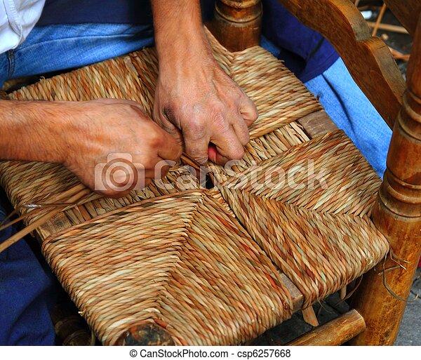 enea traditional spain reed chair handcraft man hands working - csp6257668