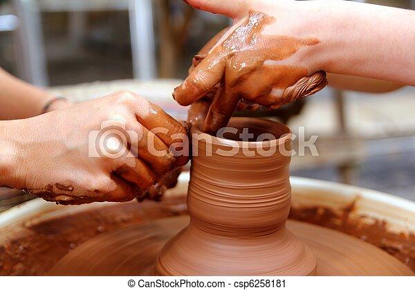clay potter hands wheel pottery work workshop teacher - csp6258181