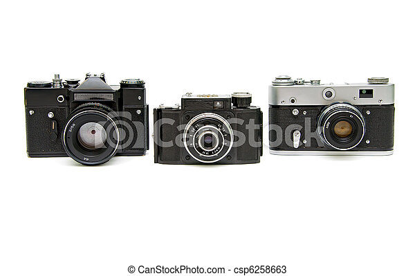 three old analog camera on a white background - csp6258663