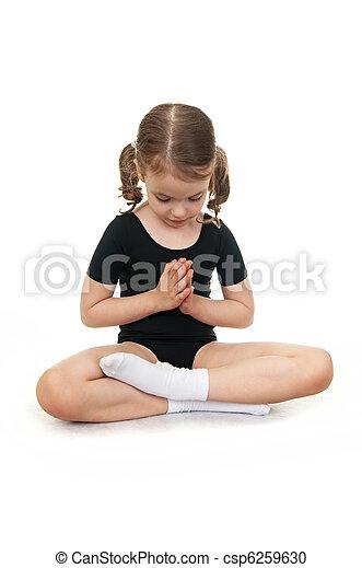 Girl in the lotus position. Children's yoga. - csp6259630