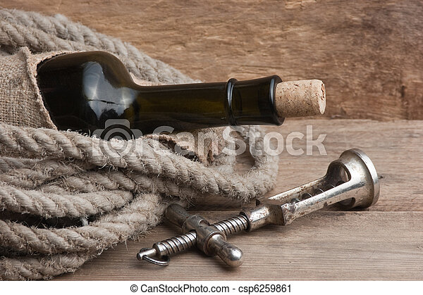 Old corkscrew and bottle of wine - csp6259861