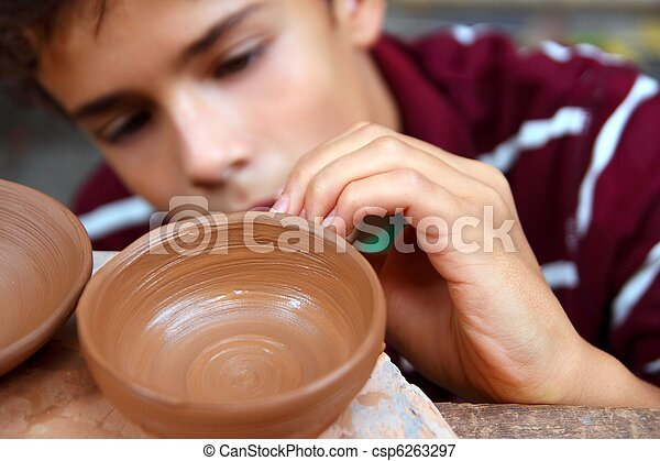 boy teen potter clay bowl working in pottery workshop - csp6263297