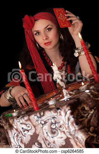 Gypsy woman sitting with cards. Isolated - csp6264585