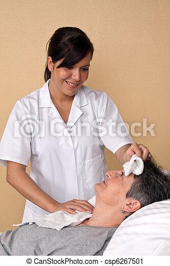 Nurse wash a patient - csp6267501