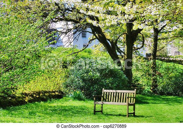 Bench in an English contry garden - csp6270889