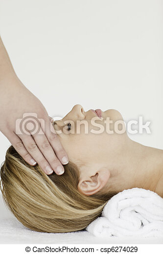 Blond-haired woman receiving a spa treatment  - csp6274029