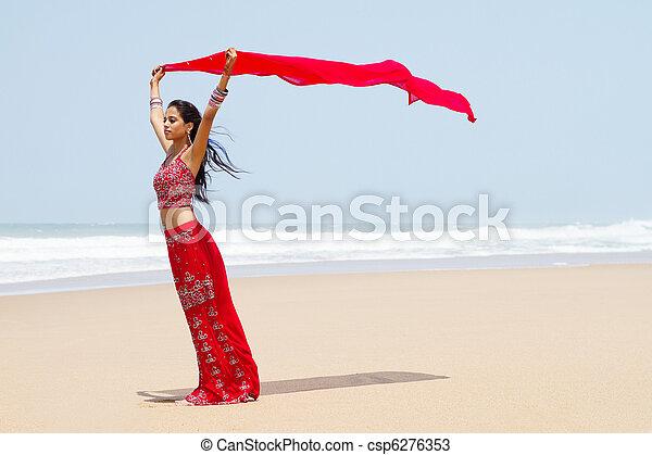 indian woman holding sari - csp6276353