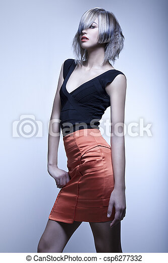 Fashion model with edgy haircut posing in studio - csp6277332