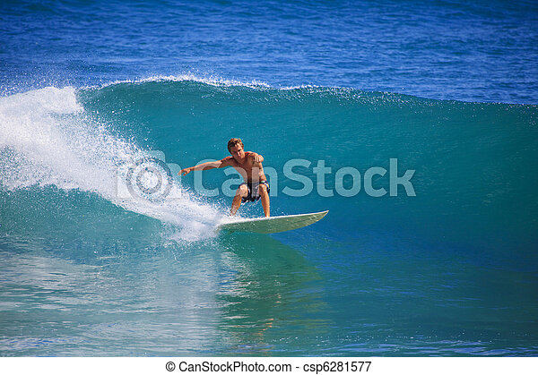 Young man surfing at Point Panic, Hawaii - csp6281577