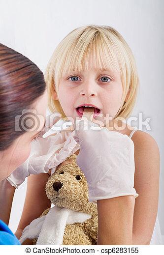 doctor examining little girl - csp6283155