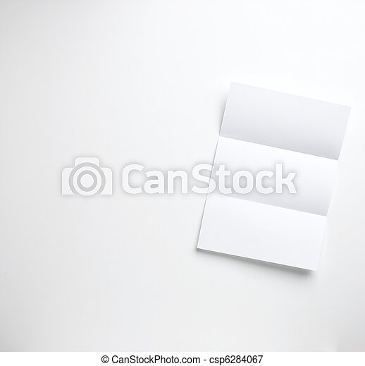 a sheet of blank folded letter paper copyspace on a white background ready for your copy - csp6284067