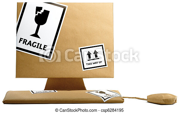 computer, keyboard and mouse wrapped in brown paper isolated on a white background ready to move office - csp6284195