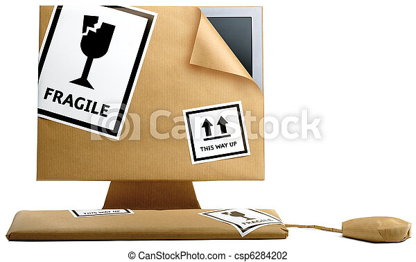 computer, keyboard and mouse wrapped in brown paper isolated on a white background ready to move office - csp6284202
