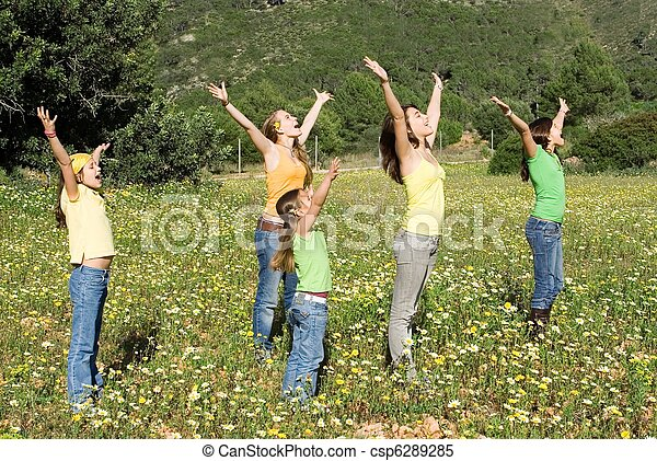 family group arms raised singing - csp6289285