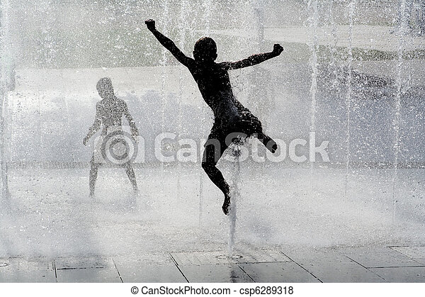 happy wet summer kids playing in water fountain - csp6289318