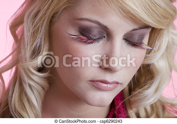 woman wearing feather eye lashes - csp6290243