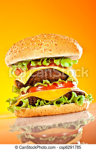 Tasty and appetizing hamburger on a yellow - csp6291785