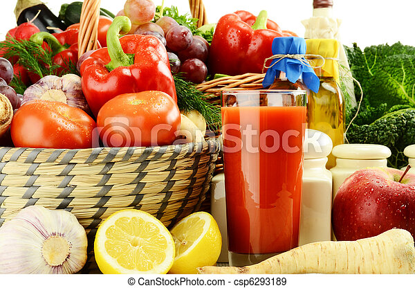 Raw vegetables with glass of juice and kitchen dishes - csp6293189