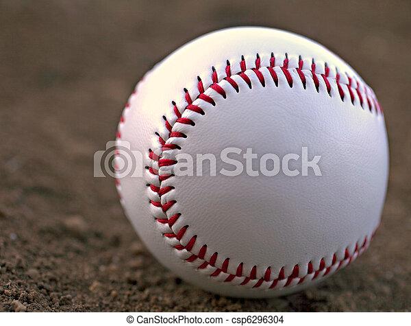 Baseball Sitting in Infield Dirt - csp6296304