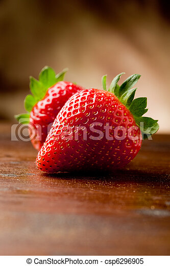 Strawberries on wooden table - csp6296905