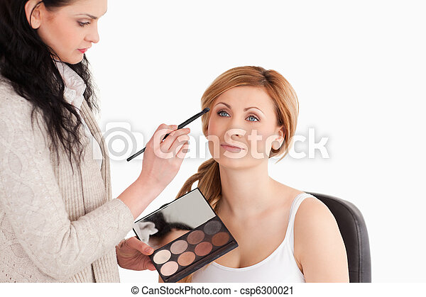 Young woman being made up by a make - csp6300021