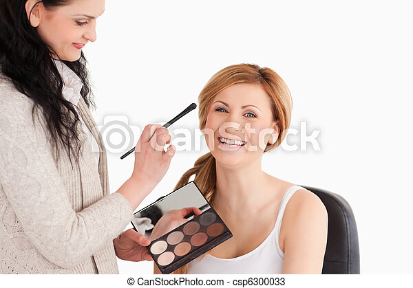 Young woman being made up by a make - csp6300033