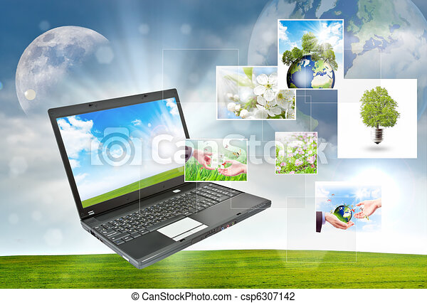 Laptop against green nature background - csp6307142