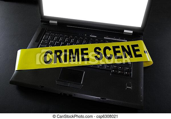laptop with crime scene tape across it - csp6308021