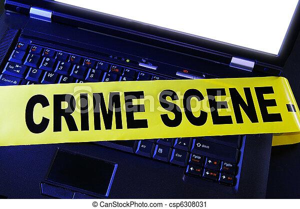 laptop with yellow crime scene tape across it - csp6308031