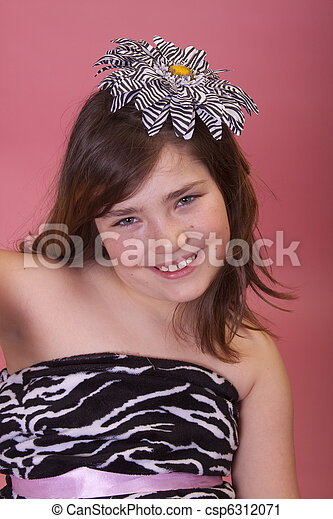 Pretty preteen wearing zebra shirt and flower in her hair