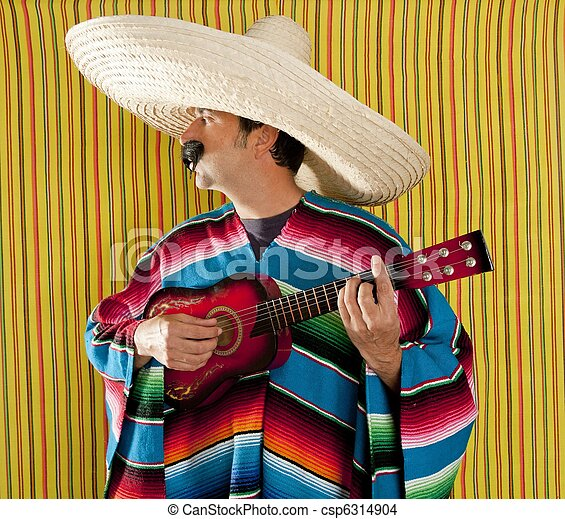 Mexican man serape poncho sombrero playing guitar - csp6314904