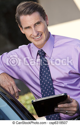 Successful Businessman Using Tablet Computer or iPad - csp6318507
