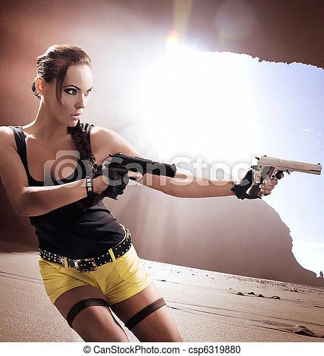 Gun woman strikes back - csp6319880