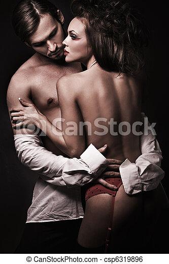 sexy woman in red underwear undressing a man - csp6319896