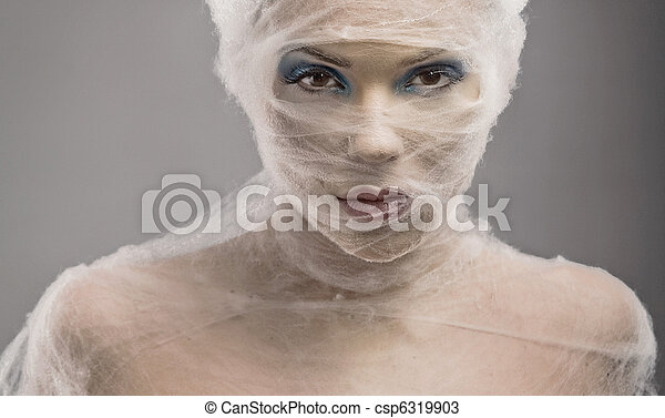 Fine art portrait of a young woman in bandage - csp6319903