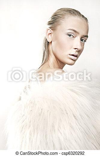 Fine art portrait of a beautiful blonde in white fur - csp6320292