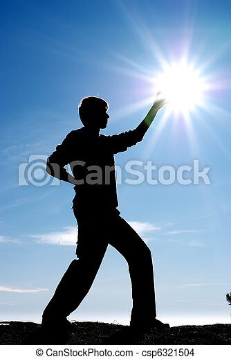Silhouette of persons and sun - csp6321504