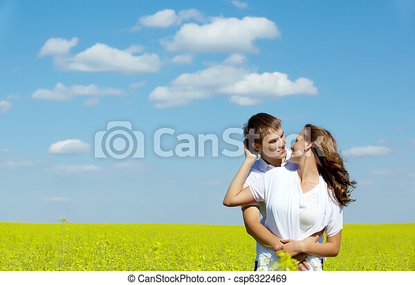 Image of happy couple in yellow meadow at summer