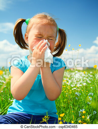 Little girl is blowing her nose - csp6340465