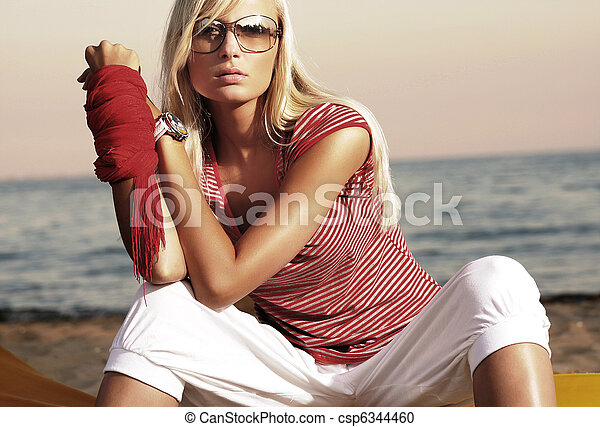 Fashion style photo of an attractive woman in sunglasses - csp6344460