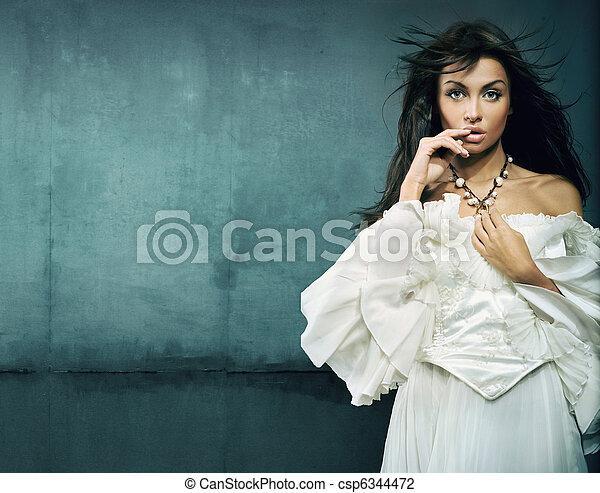 Stunning brunette beauty wearing vintage dress - csp6344472