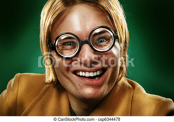 Funny guy grimacing over green background - csp6344478
