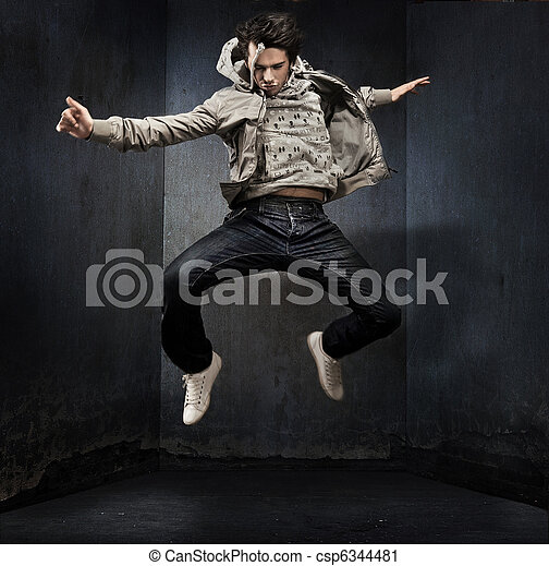 Young hip-hop dancer over a grunge wall - csp6344481