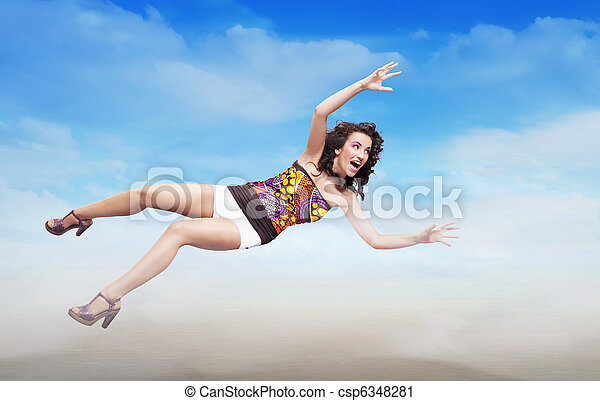 Young brunette beauty jumping over sky background, lots of copy-space - csp6348281
